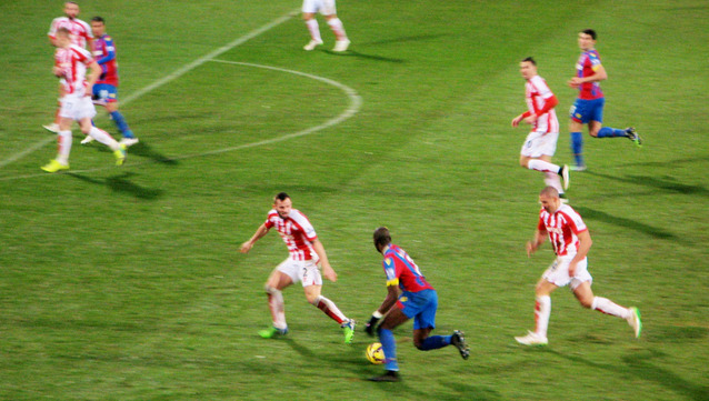 Yannick Bolasie, never daunted, runs at a packed Stoke defence.