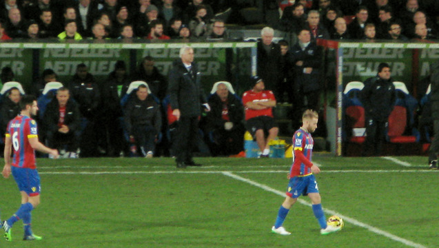 Alan Pardew in characteristic position for his home managerial debut against Tottenham Hotspur