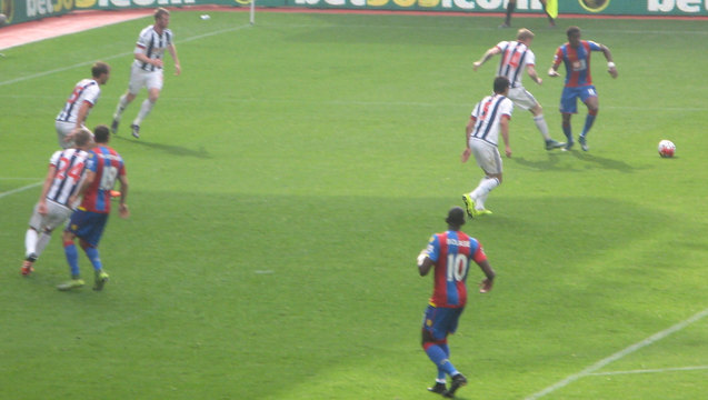 Yannick Bolasie lurks near the Baggies' goal before nodding in the first
