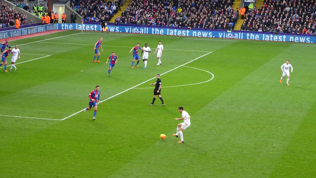 Swansea on the offensive as Yohan Cabaye runs to stifle an attack during the goalless draw.
