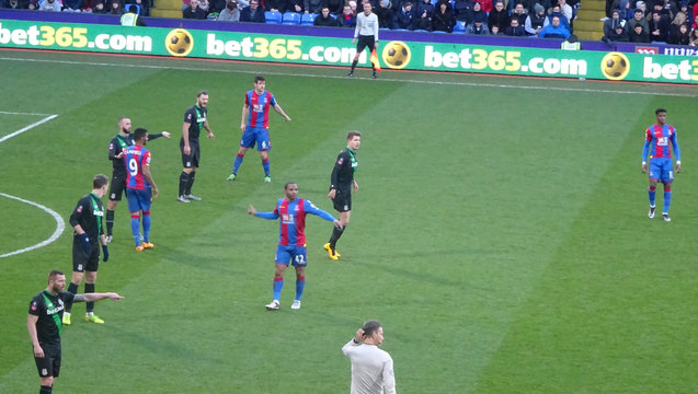 Puncheon conducts the choir as Clattenburg wonders why are the crowd singing
