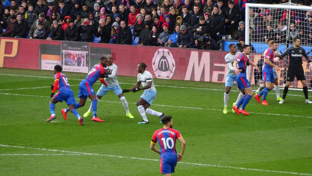 Townsend (No 10) runs at the Hammers goal as the Eagles deliver a first-half corner