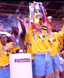 Neil Shipperley holds aloft the play-off trophy