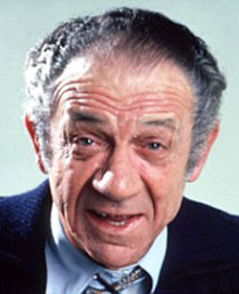 Neil Wormcock played by Sid James