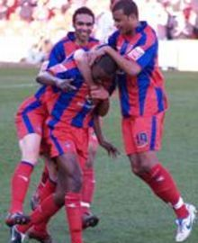 Leon Cort celebrates with team-mates after scoring against Ipswich