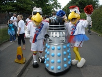 chriskb at the Carshalton carnival in his Dalek costume (note the red and blue lights) with Pete and Alice the Eagle