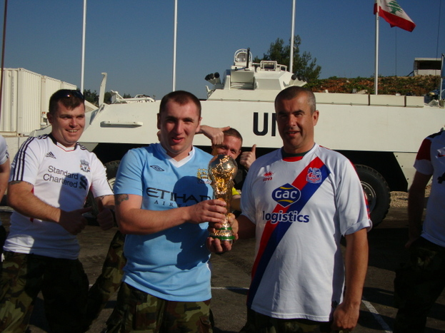 Eddie McGrath holding the World Cup in South Lebanon